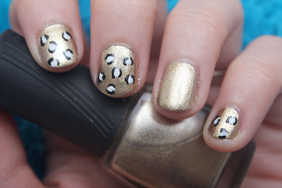 Black, white and gold leopard nail art.