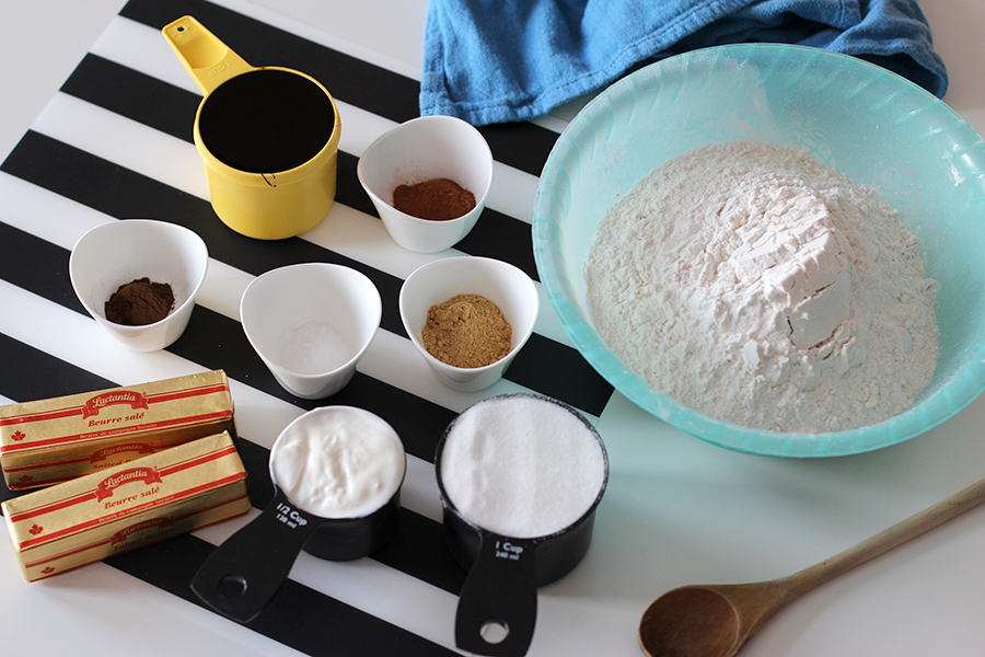 Ingredients for egg free gingerbread cookies; flour, yogurt, spices, molasses, butter, sugar.