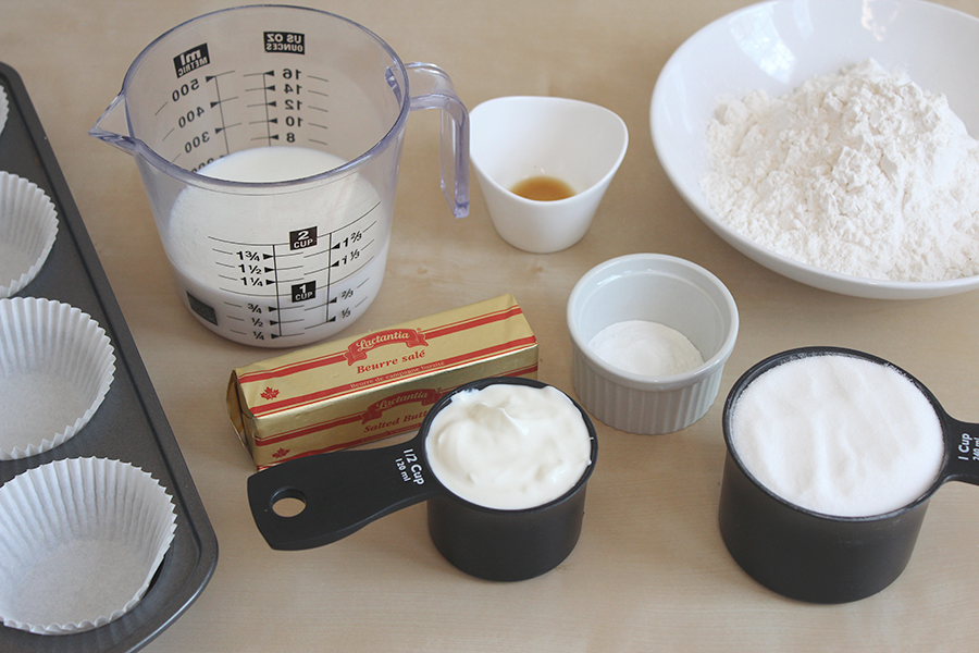 Ingredients for egg free vanilla white cupcakes (cake); flour, yogurt, butter, milk, sugar, baking powder, vanilla.