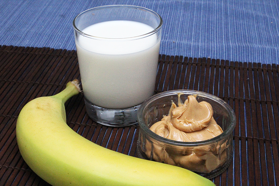 Ingredients for a quick and easy breakfast; banana peanut butter milkshake.