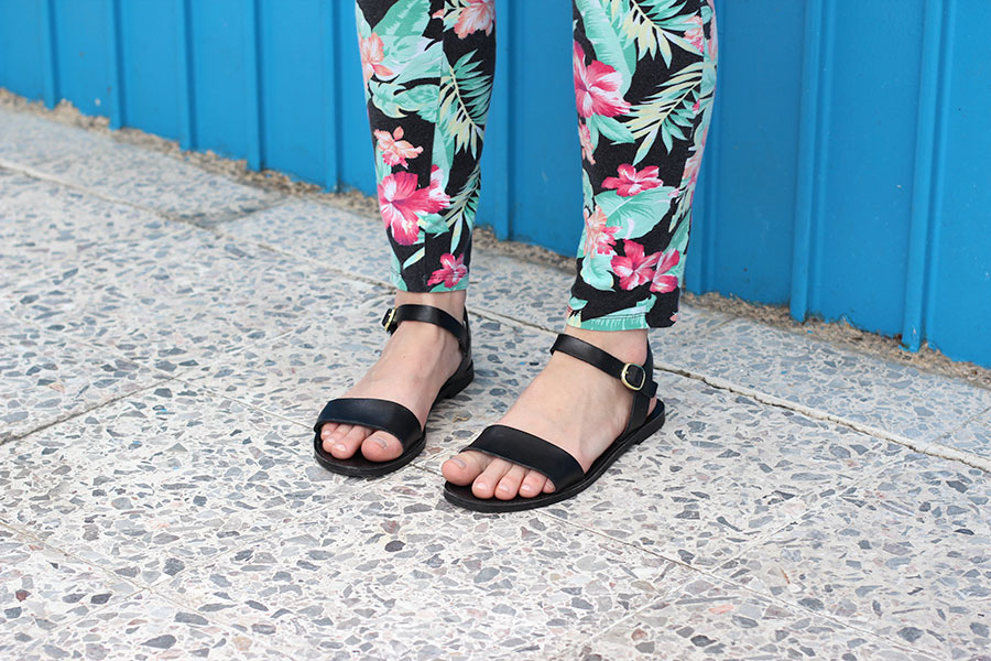 Steve Madden black sandals with floral leggings.