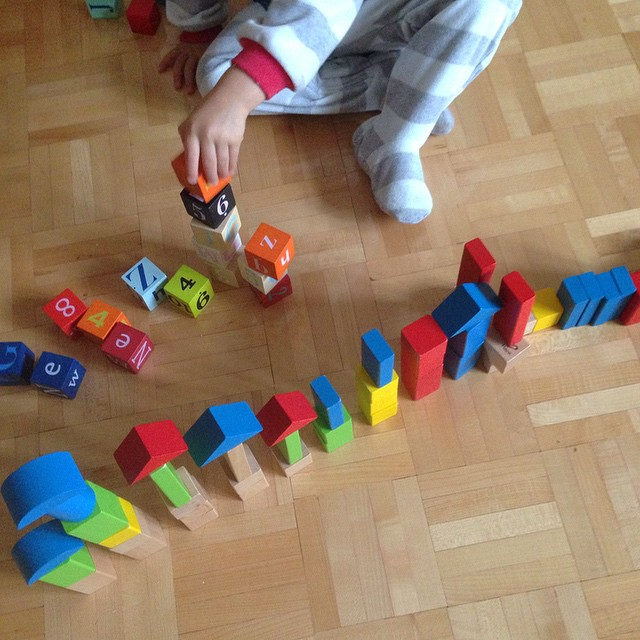 little boy playing with wooden blocks.jpg