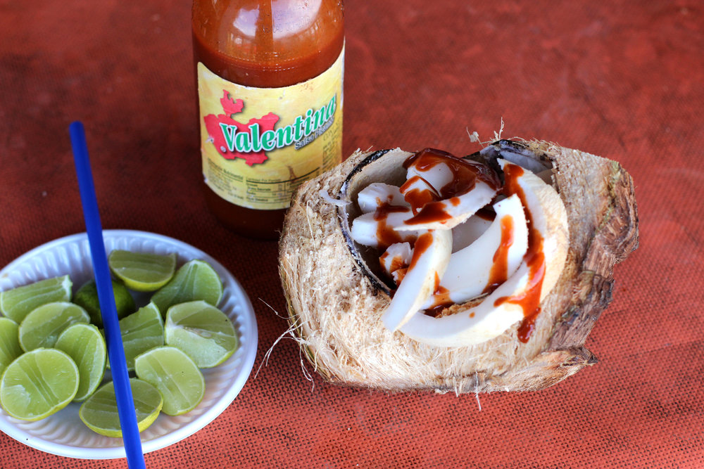 mexican food coconut with chamoy sauce and lime.jpg