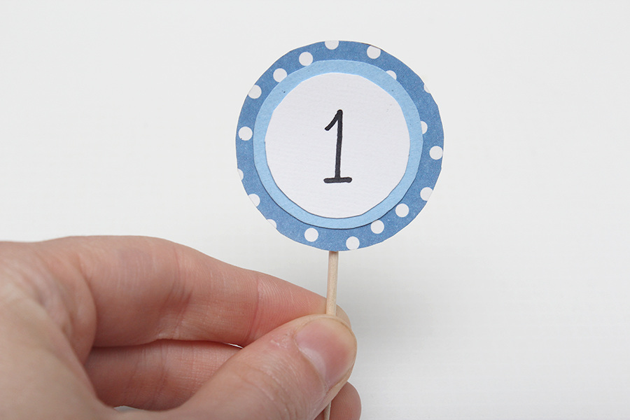 blue and white 1 year old cupcake toppers.jpg