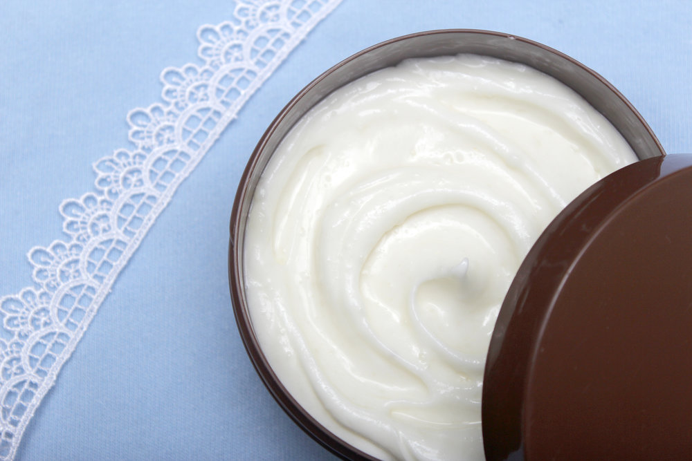 homemade moisturizing lotion with coconut oil and shea butter.jpg