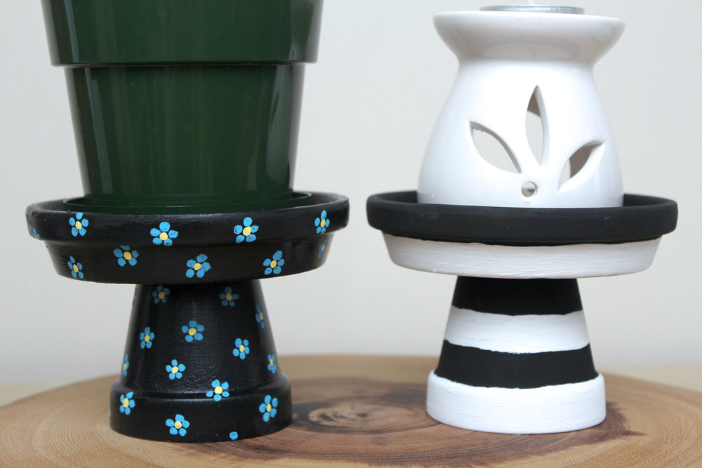 painted clay pots as plant stands.jpg