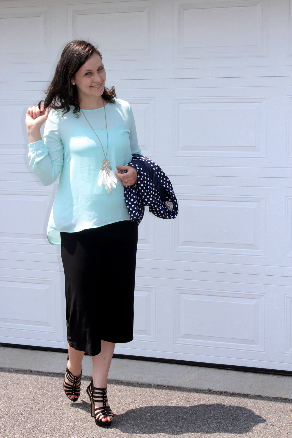 turquoise blouse navy blue polka dot jacket black pants playing with hair.jpg