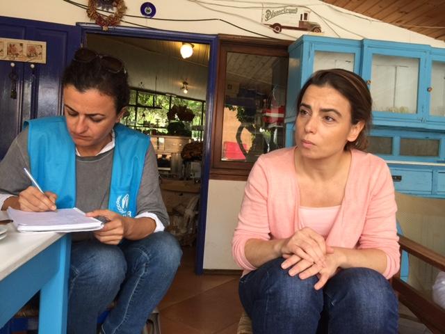 Shanti Representative Iphigenia (right) with UNHCR Officer (left)