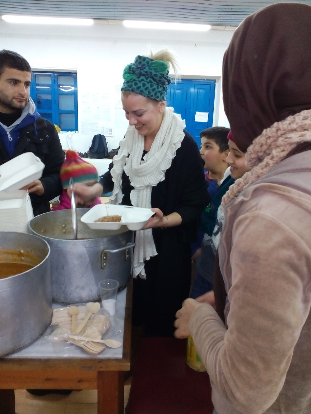 January 2016 - Magda our volunteer serving the common meal
