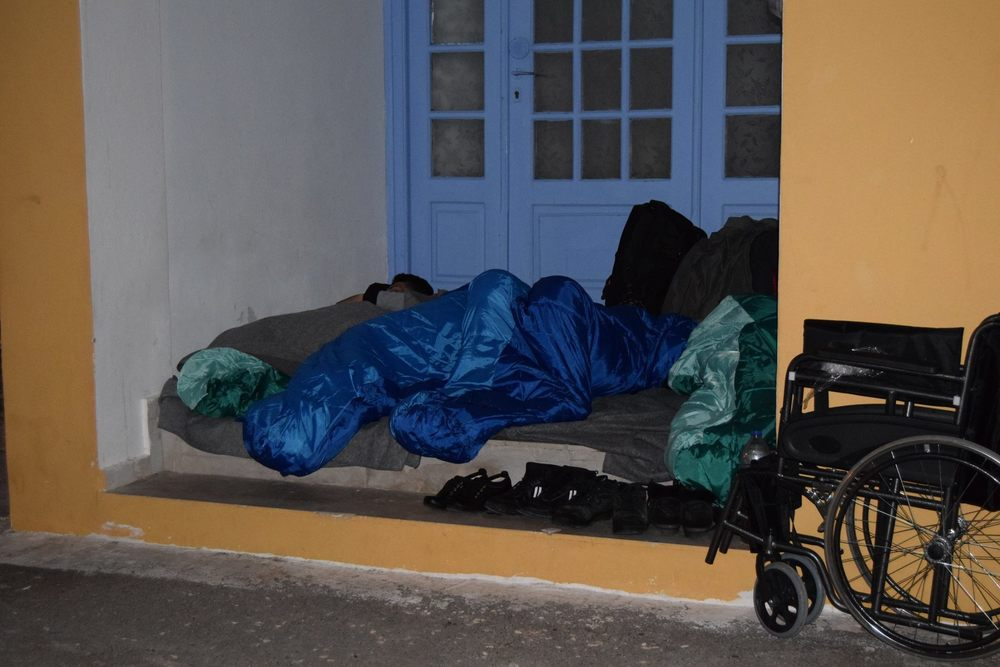 29/02 A group sleeping outside after the closure of the hall, including a disabled boy with a donated wheelchair