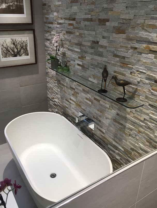 Stand alone bath, fittings and tiling on display in our showroom.