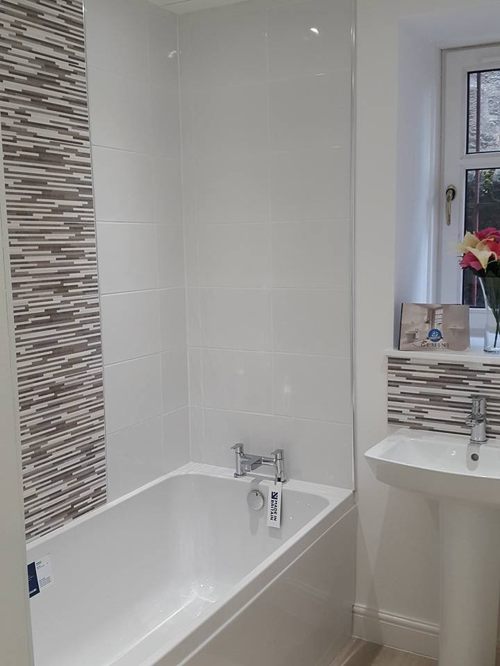 Bathroom suite with fittings and tiling on display in our showroom.