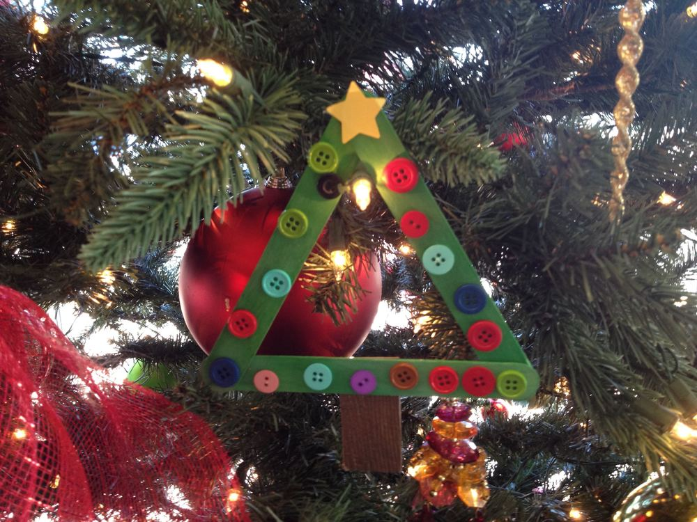 Handmade popsicle Christmas tree ornament hanging at Rolla City Hall.