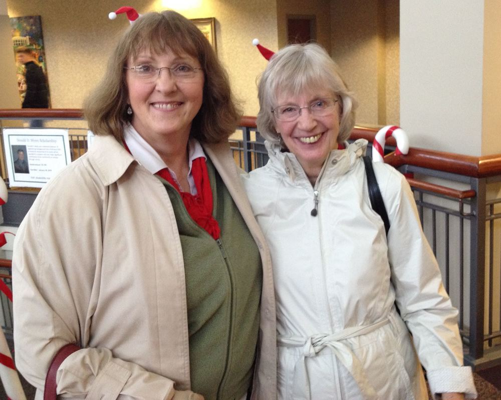My gardening friend Ina was the first one to get one of the extra tiny Santa hat fascinators.