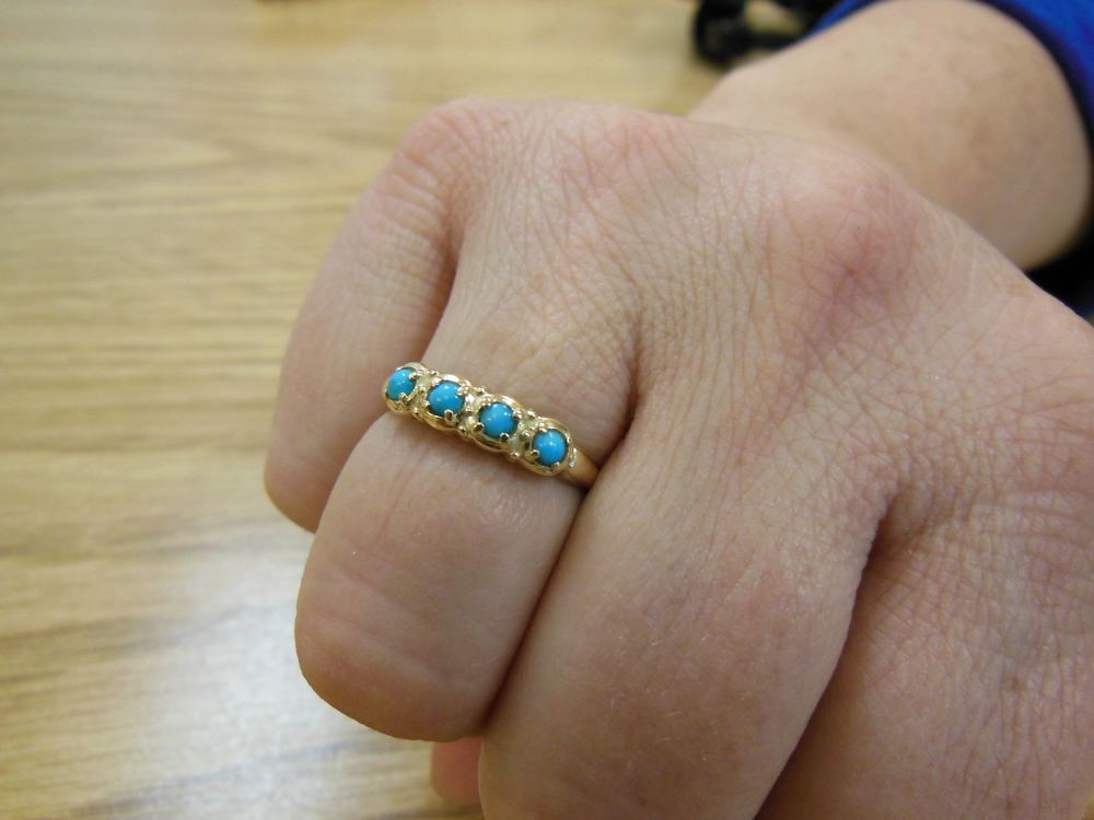 My physical therapist Kellys' beautiful Persian turquoise gold ring.