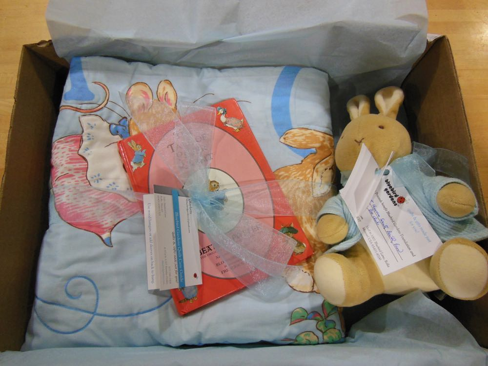 Our custom Peter Rabbit Crib Quilt gift set ready to ship for a shower in New York.