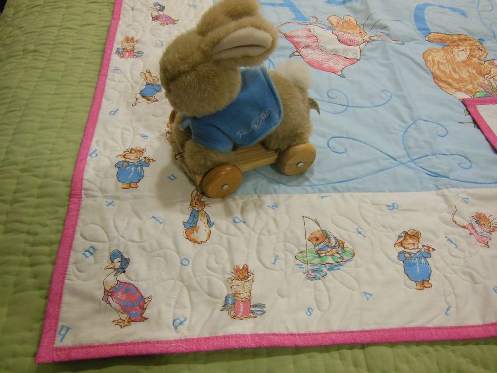 We added a pink border so little girls can have a Peter Rabbit crib quilt in their girly nursery.