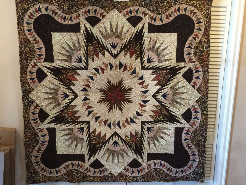 This is a quilt my neighbor Diane had someone quilt for her, she did the piecing.