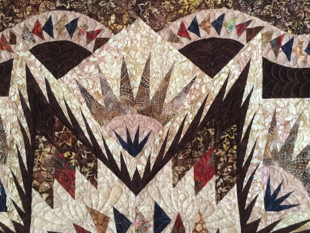Diane's quilt design features very detailed piecing work.