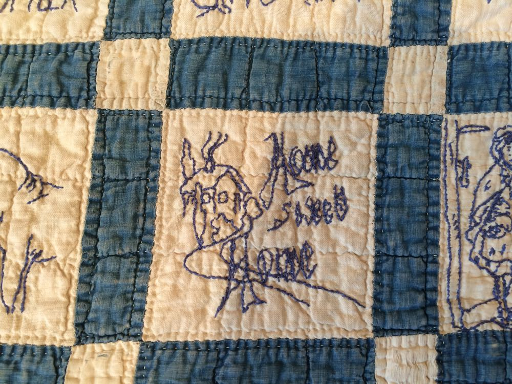 """Another favorite saying """"Home Sweet Home"""" in vintage blue work child's quilt."""