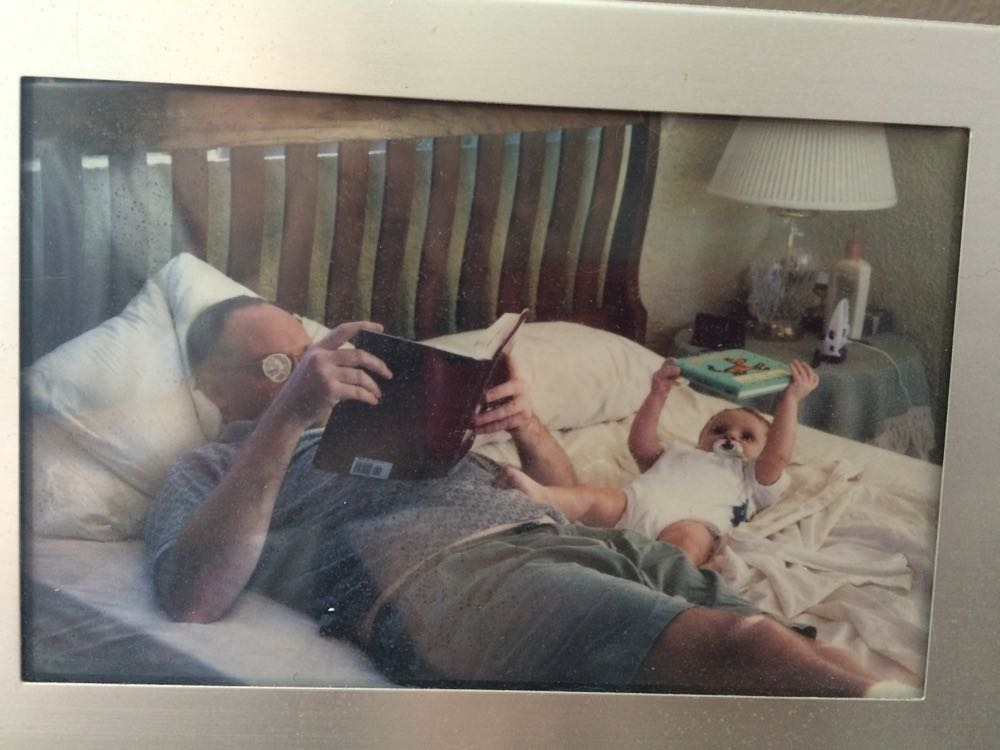 My brother David and his son Alex enjoying some reading time together.