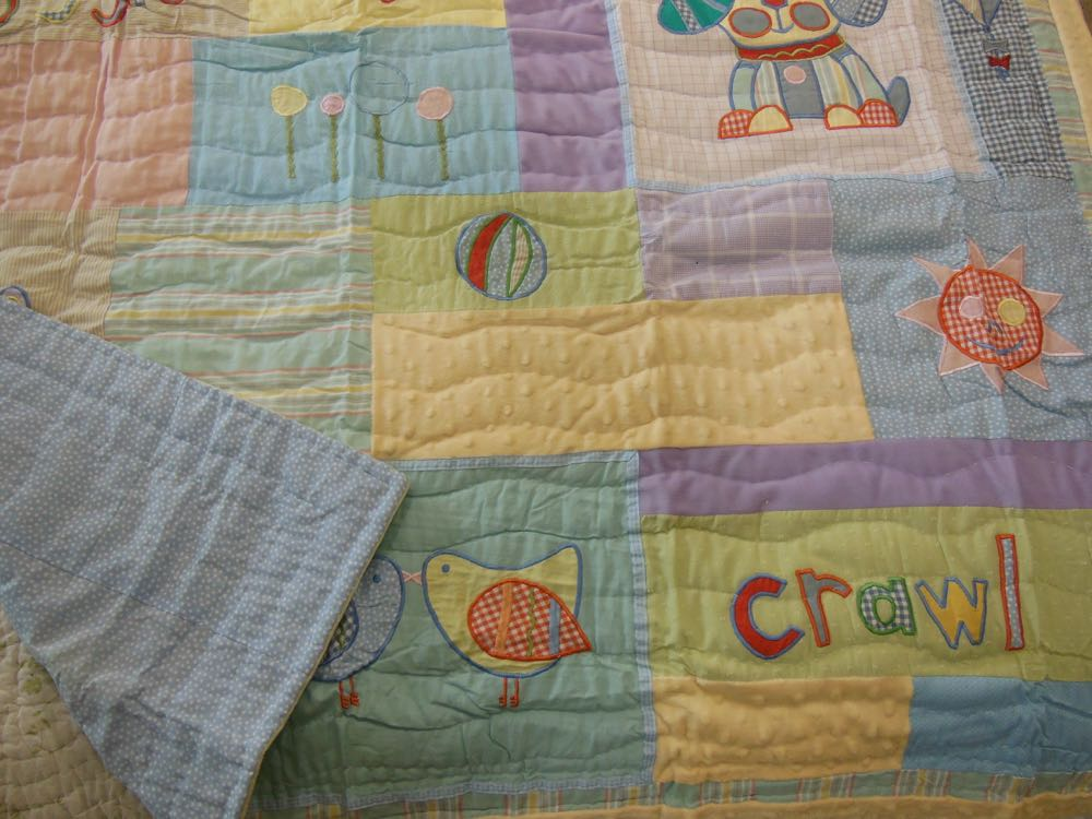 Play and Giggle Baby Quilt and Throw has several fabric blocks that can be personalized.