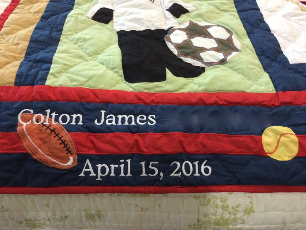 Play to Win Throw with custom embroidery at the bottom by Bluebird Gardens.
