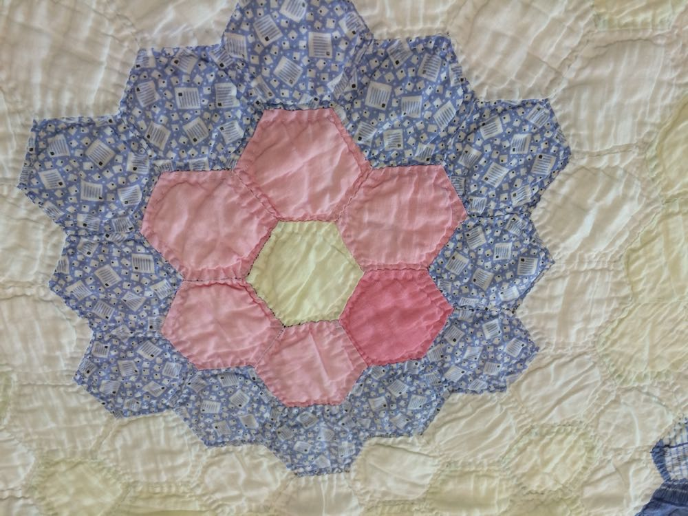 The secret of this vintage grandma's flower garden quilt is in the tradition it keeps.