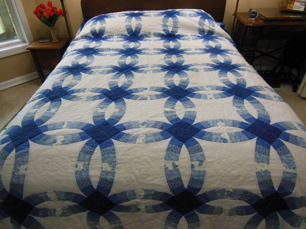 Our all blue double wedding ring quilt features a nice variety of blue-toned fabrics.