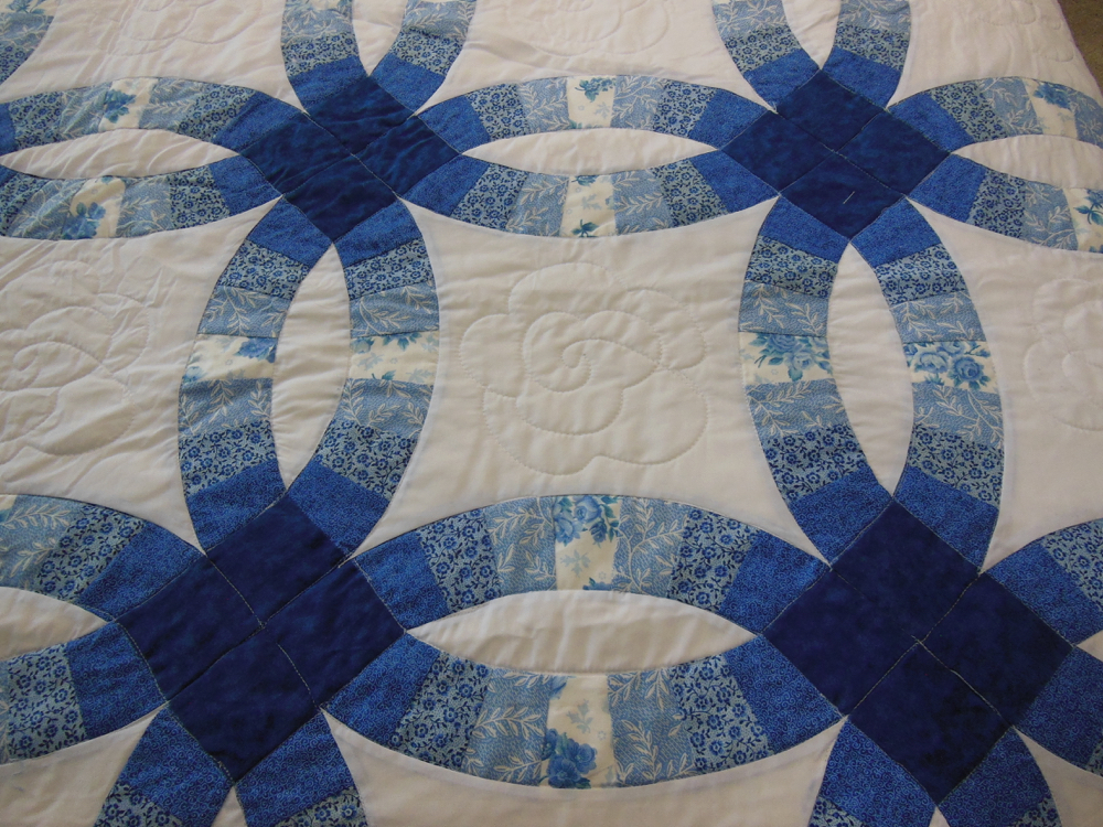 A wide range of blue fabric colors make this a very versatile gift quilt.