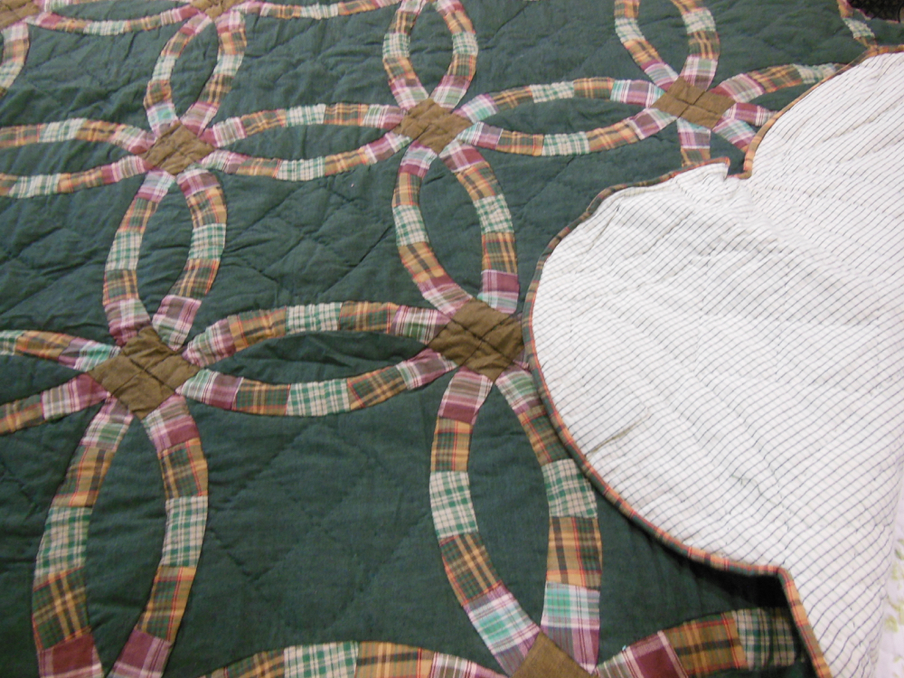 This lap quilt throw is all cotton, making this Forest Double Wedding Ring throw quite warm.