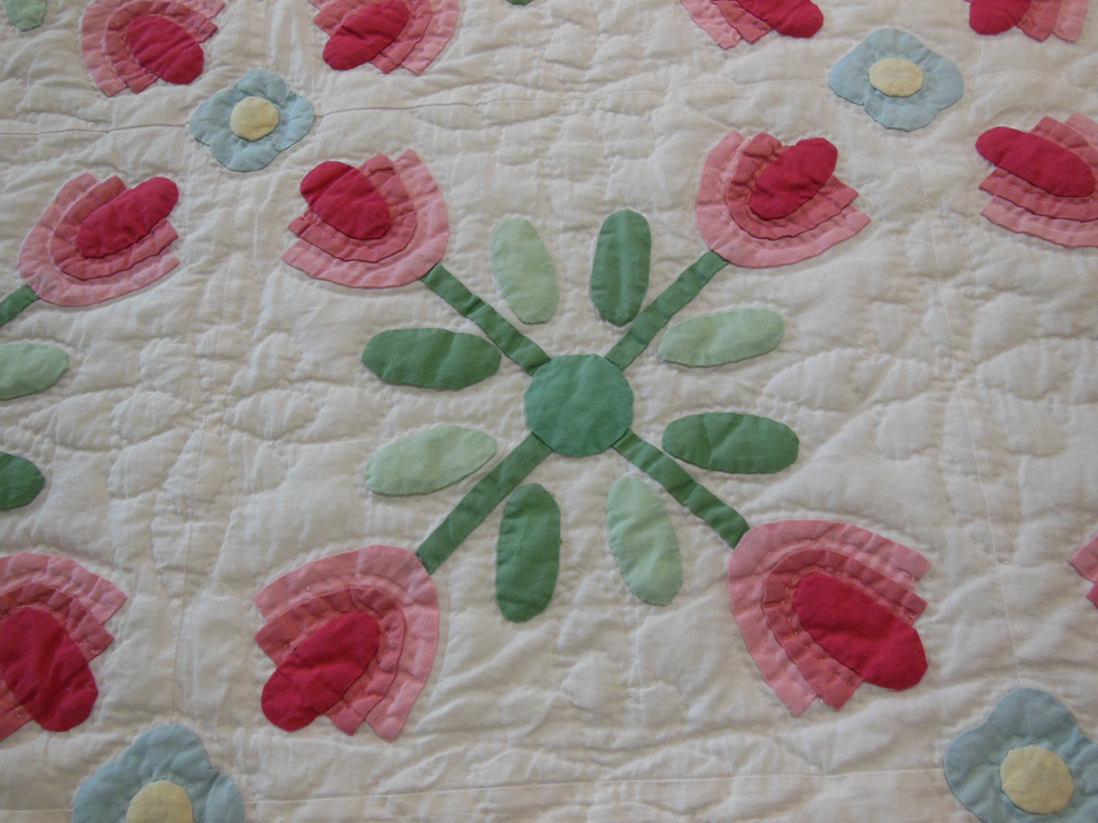 Lovely hand quilting adds another dimension to this brand new imported quilt.