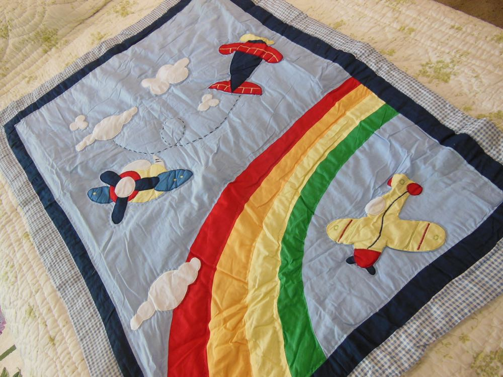 High Flying Baby Crib Quilt has primary colors that will last longer over time and wear.