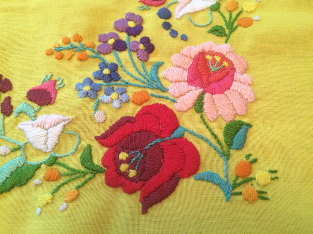 Detail work in the hand-embroidery for this beautiful table cloth.