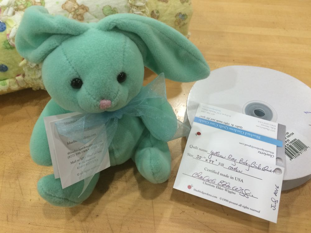 Rabbit toy has gift tag and we also include a certified quilt care card with quilt information.