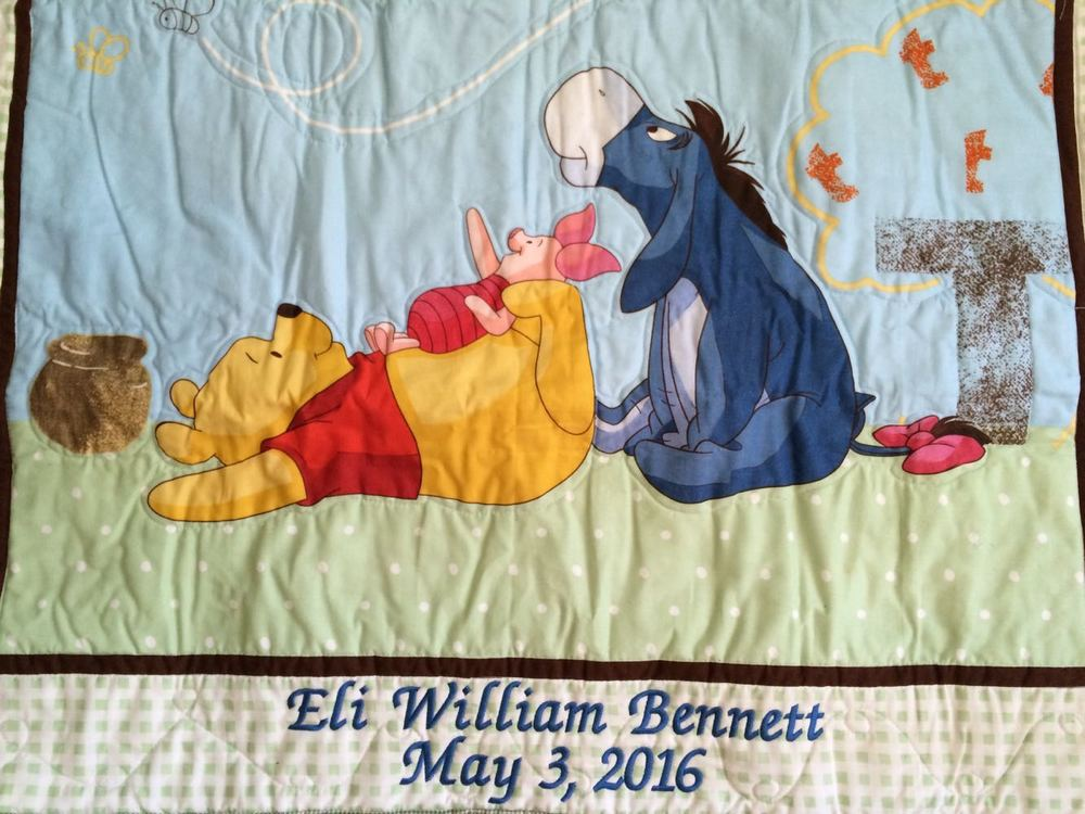 Our Pooh Bear Baby Quilt has been personalized with the baby's full name and birth date.