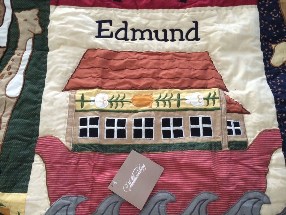 Personalized Noah's Ark baby quilt is based on a German quilt design in Williamsburg Collection.