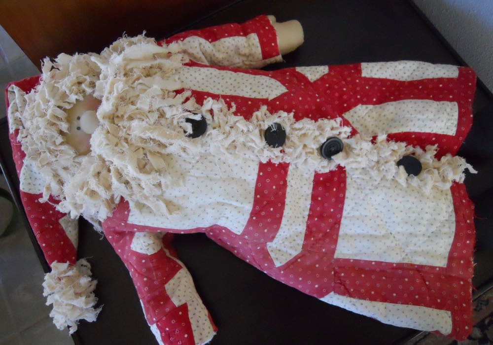 Red and White Old Quilt Santa Claus dolls is made all out of fabric.