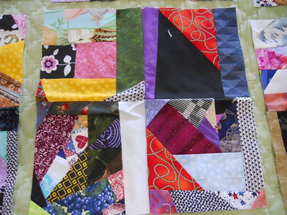 A 12x12-inch crazy quilt block that can easily be made into an accent pillow.