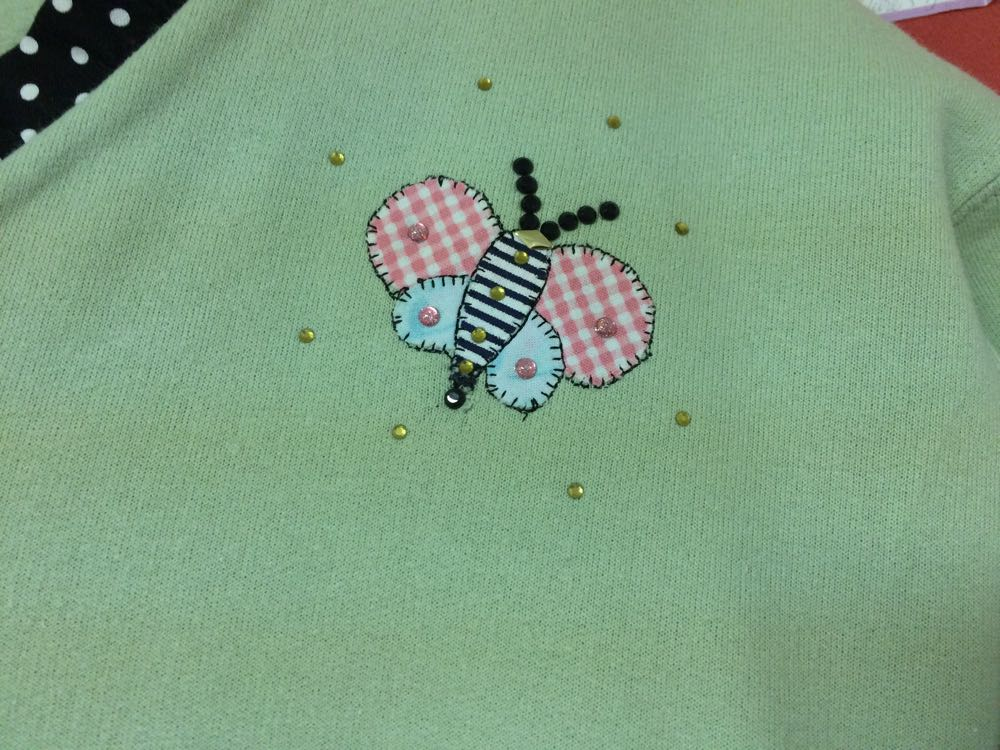 I caught this cute embellished and hand-applique butterfly out of the corner of my eye.
