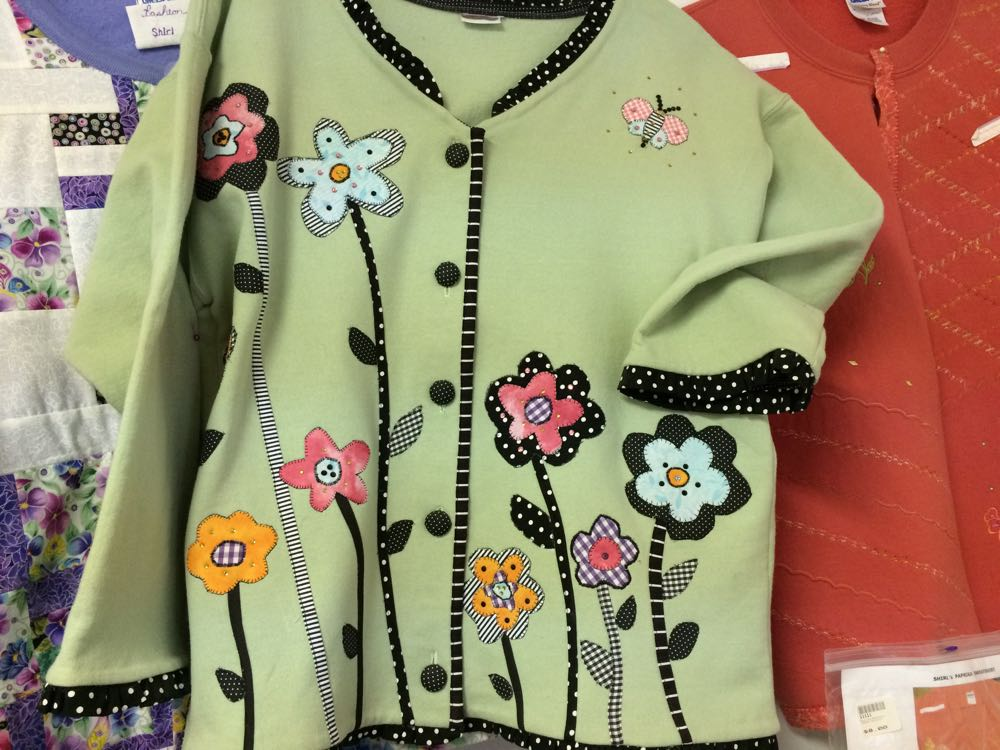The garden was on the front of a charming green jacket, perfect for a spring garden walk!