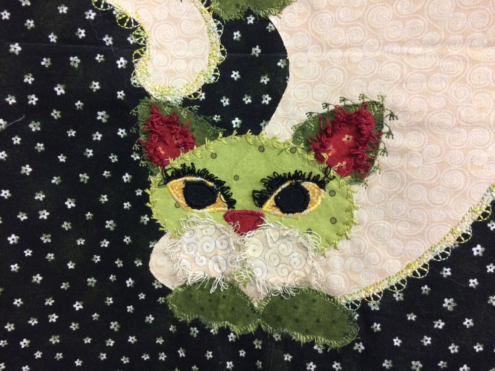 Love the detail in this applique cats, especially the white muzzle and fluffy tail.