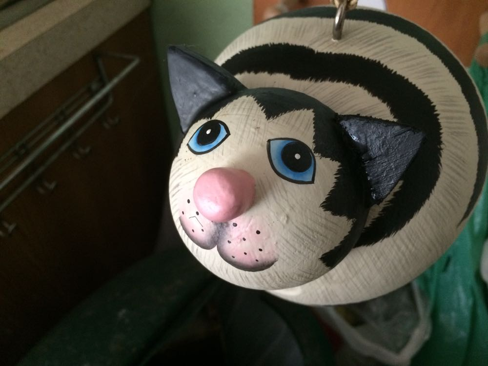 This little cat gourd birdhouse was missing an ear so I added one. Can you tell which one?