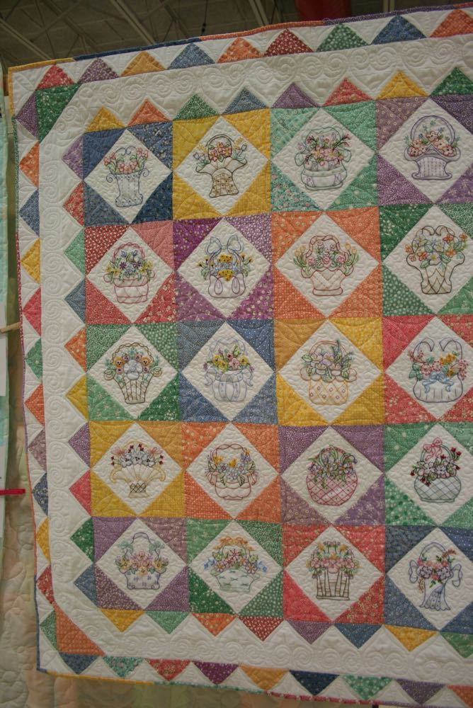 Love the different embroidered baskets in this custom handmade quilt at a local quilt show.