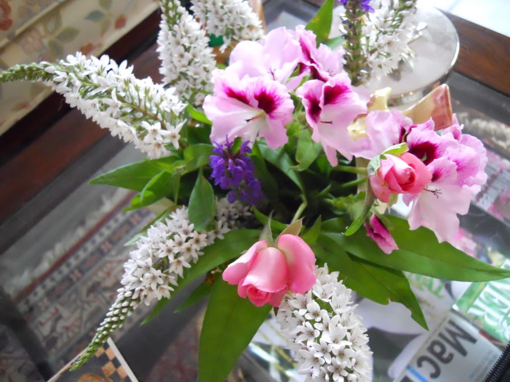 Gooseneck loosestrife with miniature roses bouquet.
