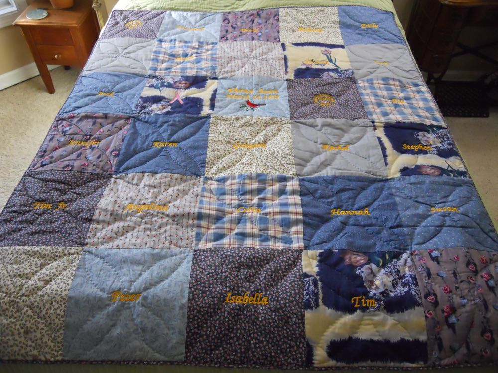 One way to personalize a handmade quilt is to add names in each of the blocks.