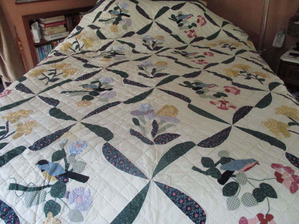 Birds in Flowers handmade quilt has two of my all-time favorite garden elements.