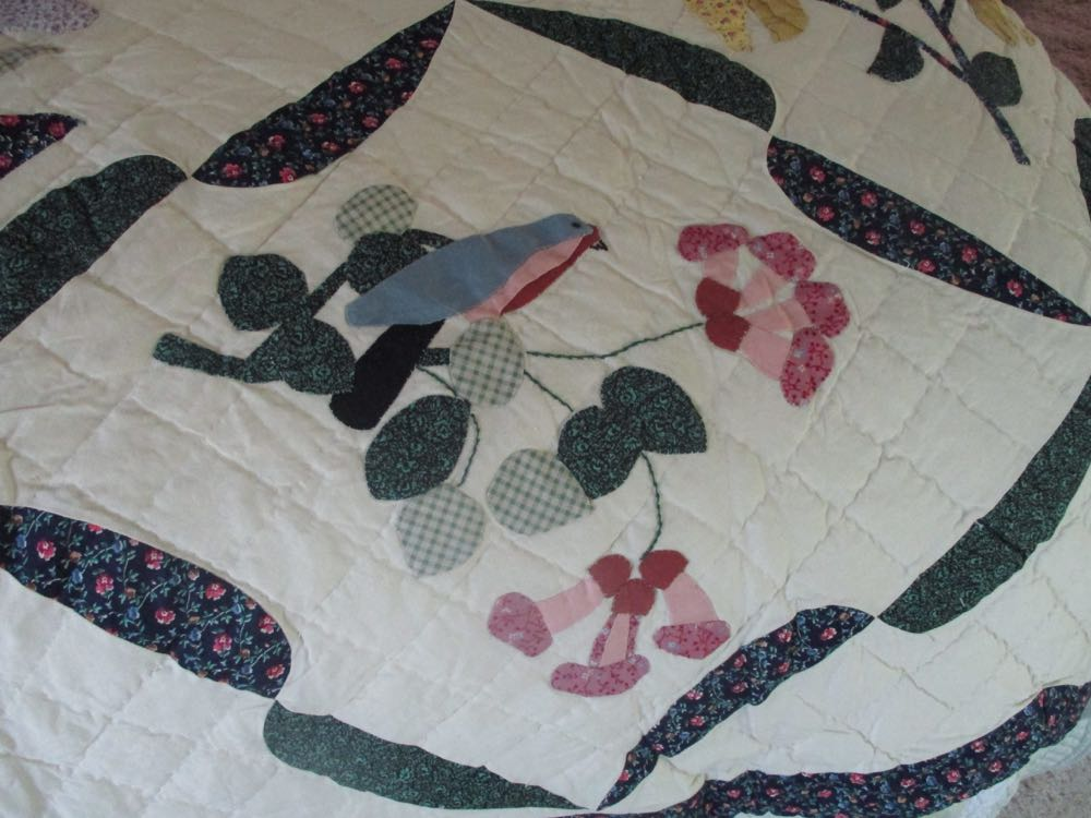 Red trumpet vines welcome a bluebird in this Birds in Flowers Handmade Quilt block.