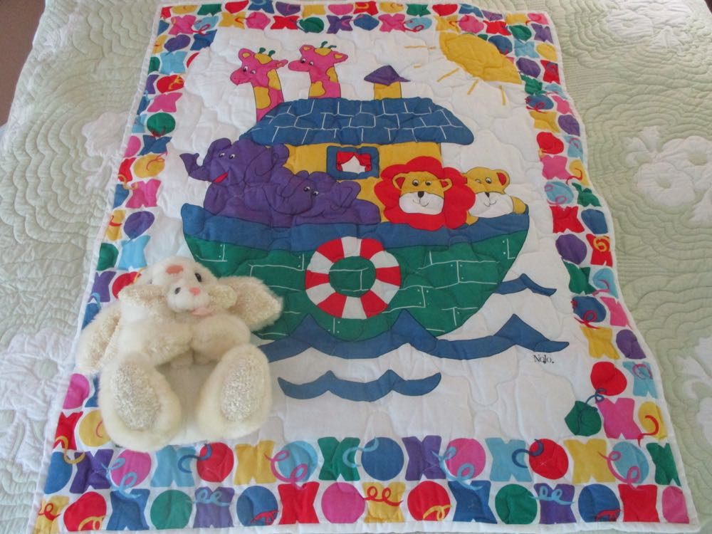 Primary colors make this charming Noah's Ark Baby Crib Quilt pop!
