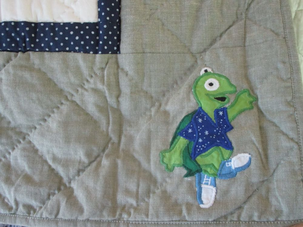 Tiny turtles in tennies run around the border of this handmade quilt throw, love the shoes!